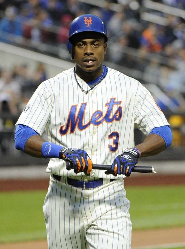 The Mets' Curtis Granderson looks to the batboy