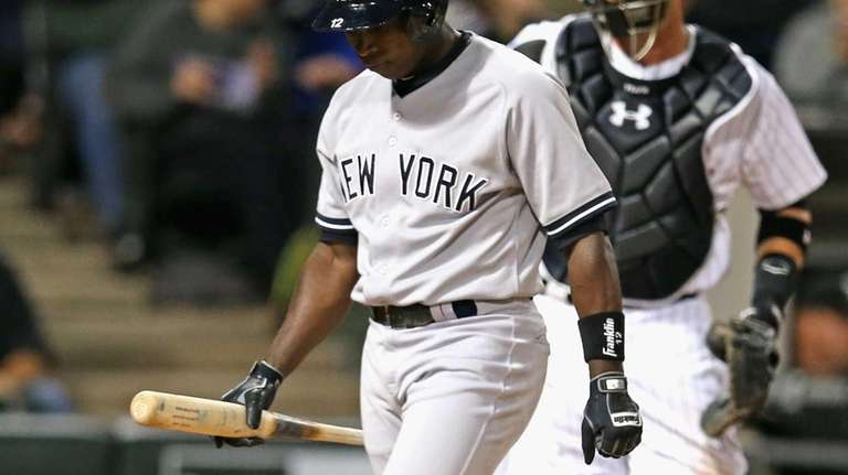 Alfonso Soriano of the Yankees walks back to