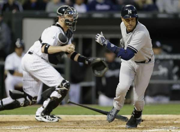Yankees' Derek Jeter, right, runs to first base