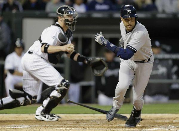 Yankees' Derek Jeter, right, runs to first base