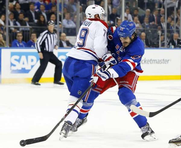Andrei Markov of the Montreal Canadiens defends against