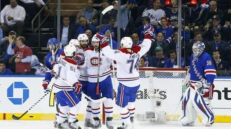 Andrei Markov of the Montreal Canadiens celebrates his