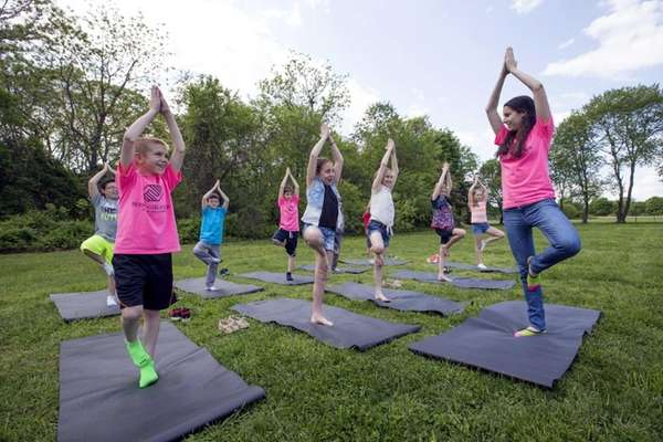 Kids practice yoga with camp counselor Amanda Mattera