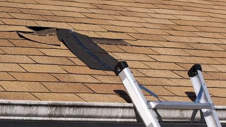 Fixing damaged roof shingles, shown here is a