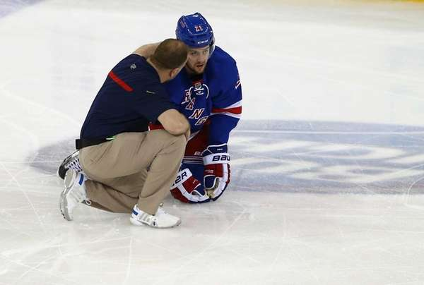 Derek Stepan is attended to by the trainer