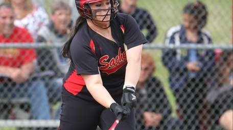 Sachem East 's Marissa Wilson hits a two-out