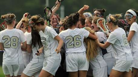 St. Dominic teammates celebrate after their 16-5 win