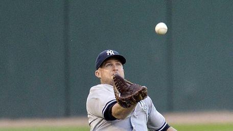 Leftfielder Brett Gardner of the Yankees catches a