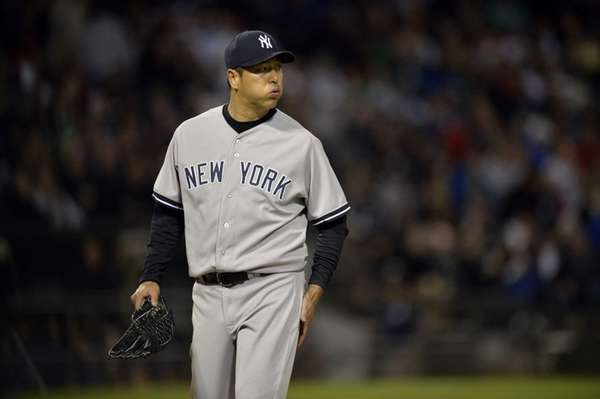 Starting pitcher Hiroki Kuroda of the Yankees walks