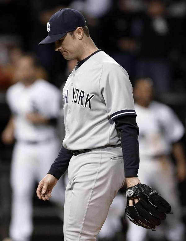 Yankees closer David Robertson looks down as he
