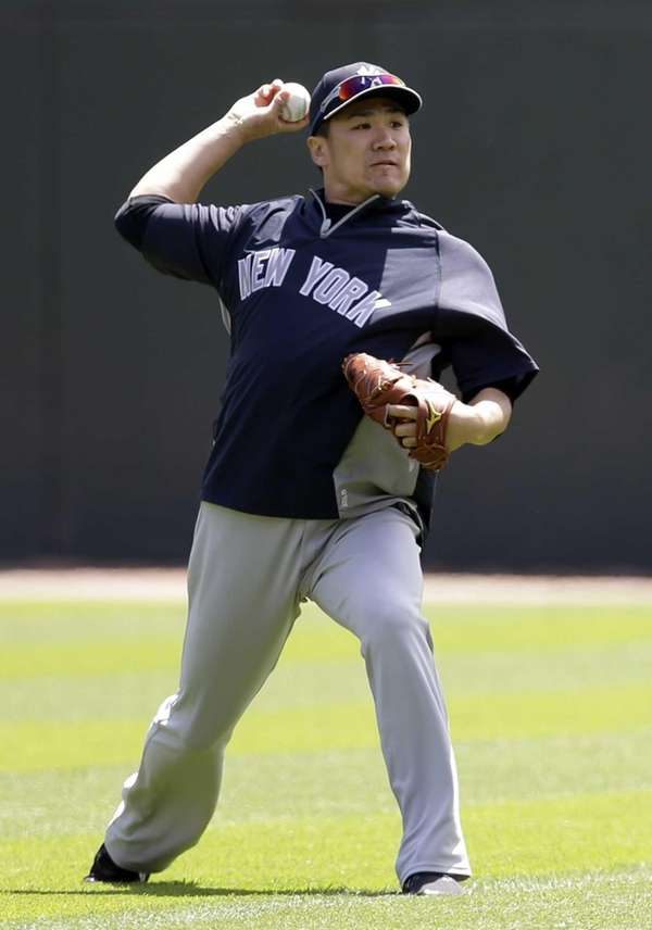 Yankees pitcher Masahiro Tanaka throws a ball on