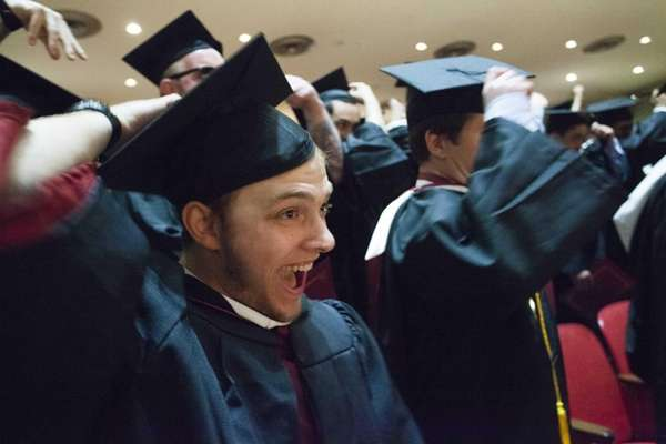 Graduates get ready to toss their mortarboards at