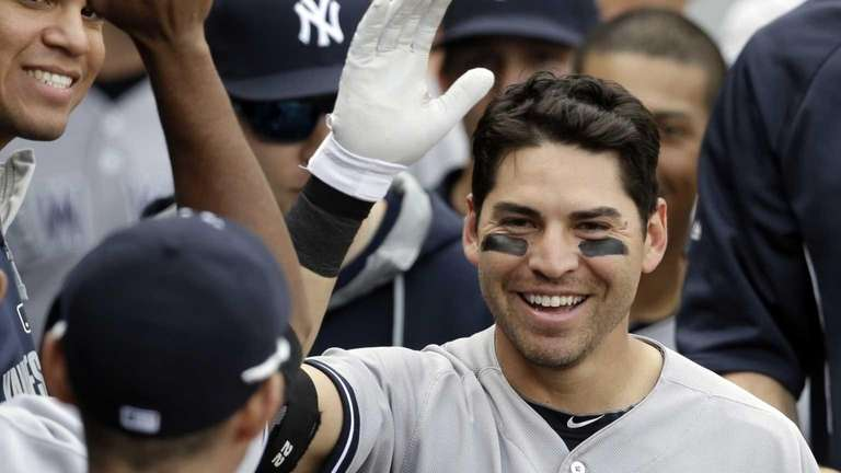 Yankees' Jacoby Ellsbury celebrates with teammates after hitting