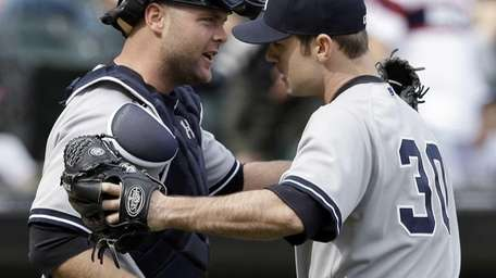 Yankees closer David Robertson, right, celebrates with catcher
