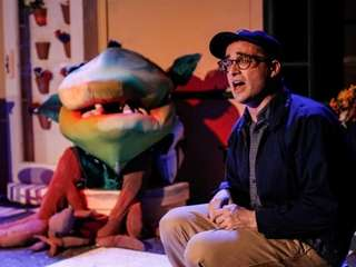 "Jeremy Hudson with Audrey II in ""Little Shop"