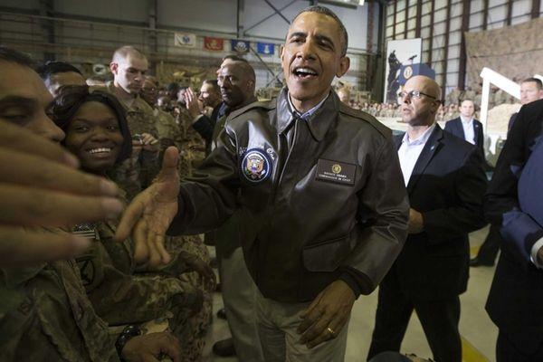 President Barack Obama shakes hands during a troop