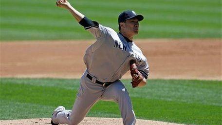 Yankees starter Masahiro Tanaka, of Japan, throws against
