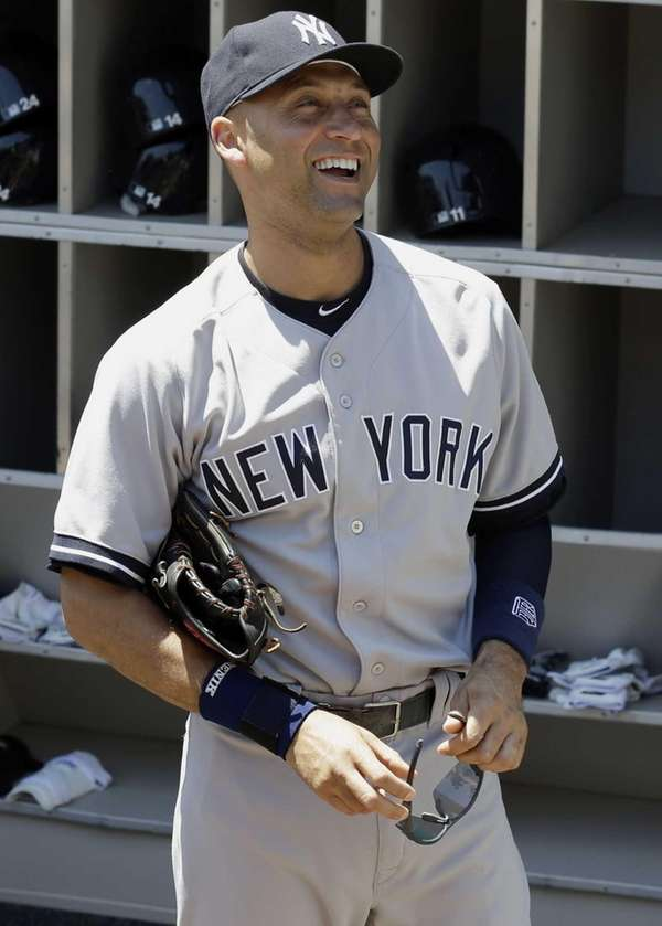 The Yankees' Derek Jeter smiles as he talks