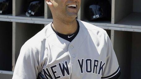 The Yankees' Derek Jeter smiles as he talks