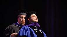 Graduate Martin Tankleff is hooded by his mentor