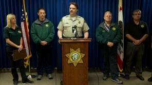 Sheriff Bill Brown, center, speaks during a news