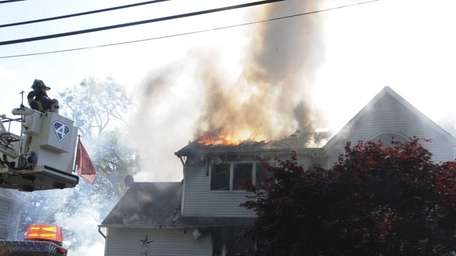 Firefighters battle a house fire for more than