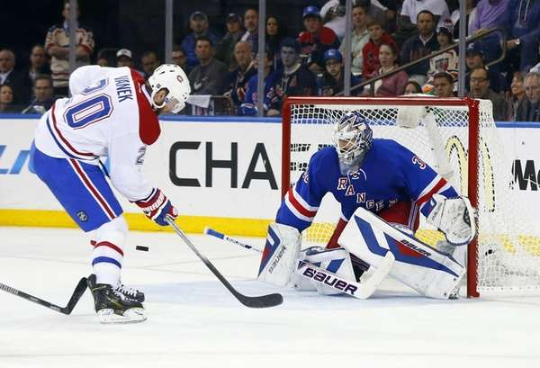 Henrik Lundqvist #30 of the Rangers stops a