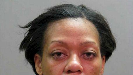 Genese M. Smith, 33, of Huntington Station, has