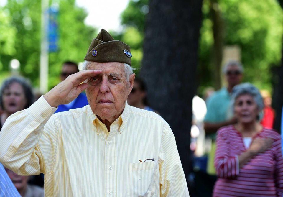 World War II veteran James A. Gray salutes