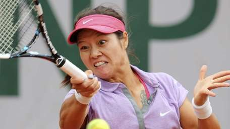 Chinas Li Na returns the ball to France's