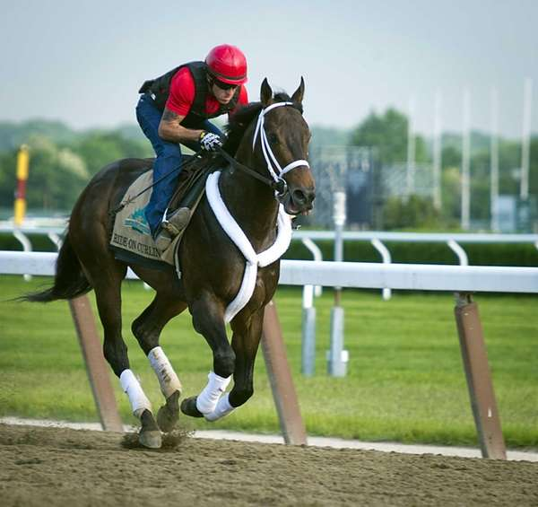 Ride On Curlin with its exercise rider Bryan