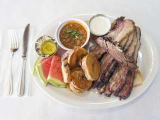 Beef brisket is tender, served with country-style beans,