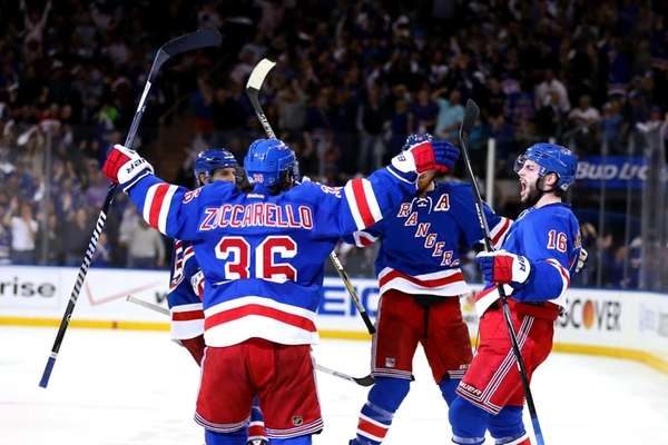 The Rangers celebrate after scoring a goal late