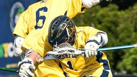 Massapequa's Ian Kirby, left, jumps to celebrate with