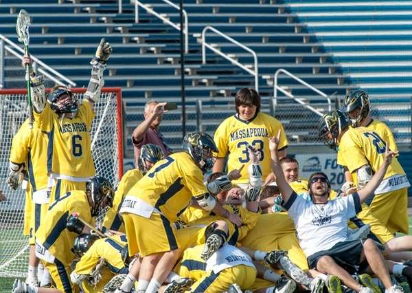 Massapequa players celebrate after defeating Syosset in the