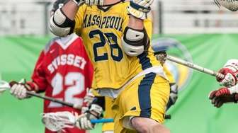 Massapequa's Paul Dilena (28) gears up and takes