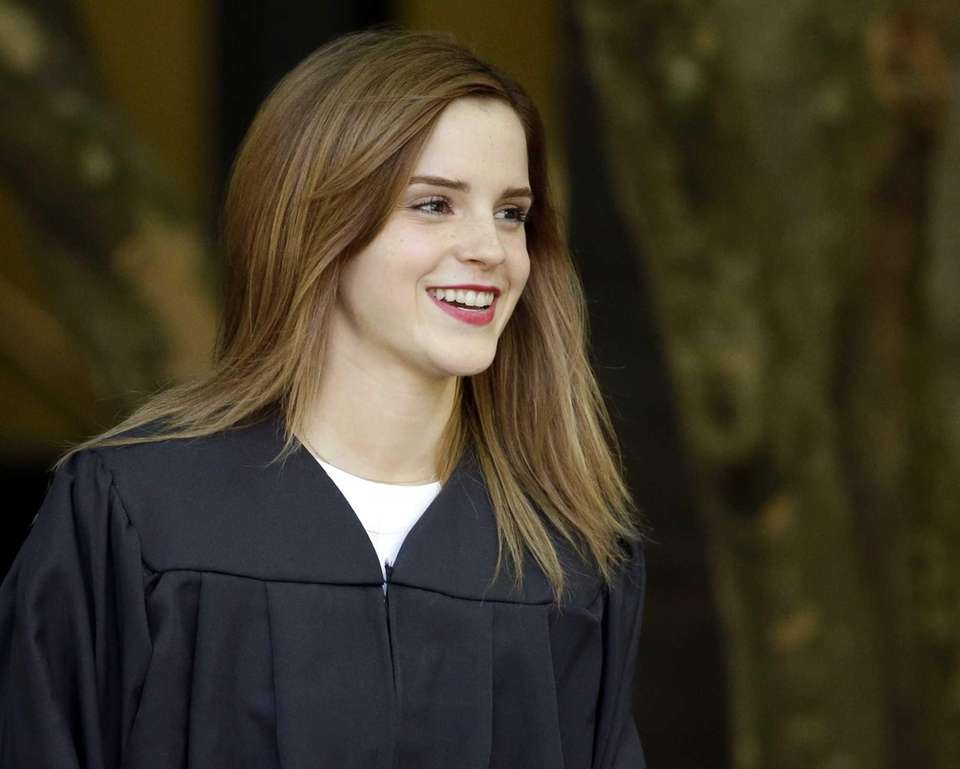 Actress Emma Watson walks between buildings following commencement