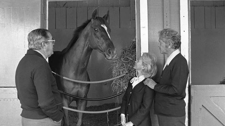 Kentucky Derby winner Affirmed is surrounded by owners