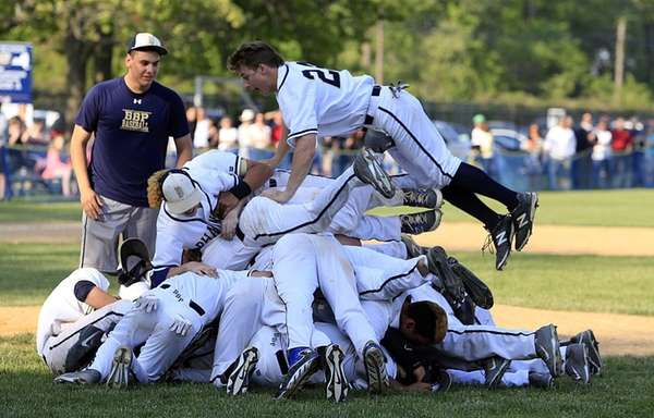 Bayport-Blue Point players pile on one another after their 4-0 victory over Shoreham-Wading River on Tuesday, May 27, 2014.