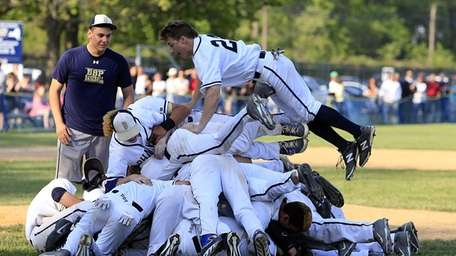 Bayport-Blue Point players pile on one another after