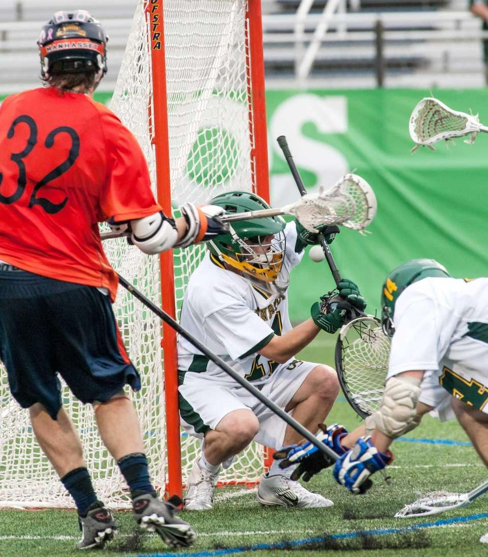 Lynbrook goalie Brendan McDougal, center, makes the save