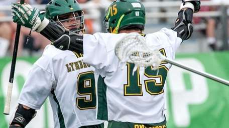 Lynbrook's Gordon Purdie, left, celebrates scoring with teammate