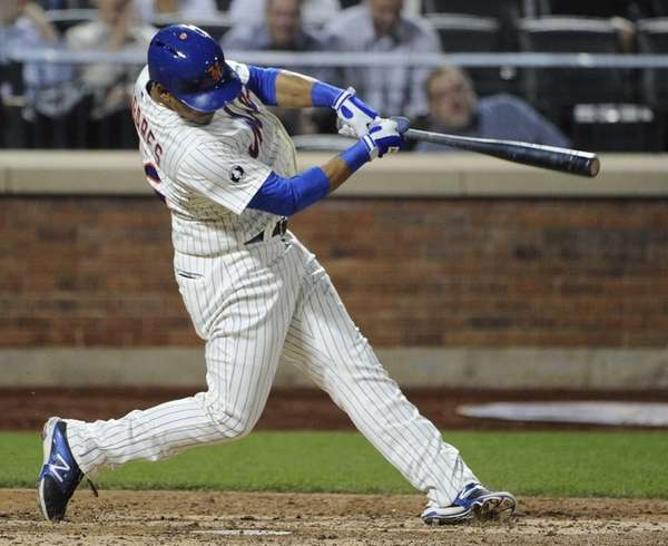 Mets' Juan Lagares hits an RBI double against