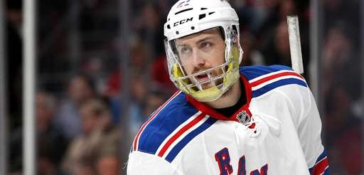 Derek Stepan of the Rangers looks on during