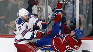 Rangers' John Moore, left, takes Montreal Canadiens' Dale