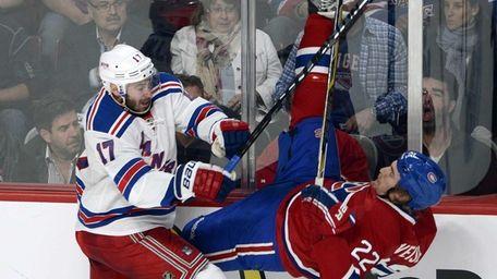 Rangers' John Moore, left, takes Montreal Canadiens' Dale
