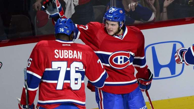 Montreal Canadiens' Alex Galchenyuk, right, celebrates with teammate