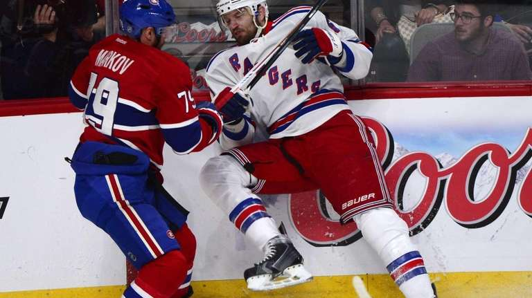 Rangers' Rick Nash, right, is taken into the