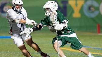 Cold Spring Harbor's Nick Tully, left, defends against