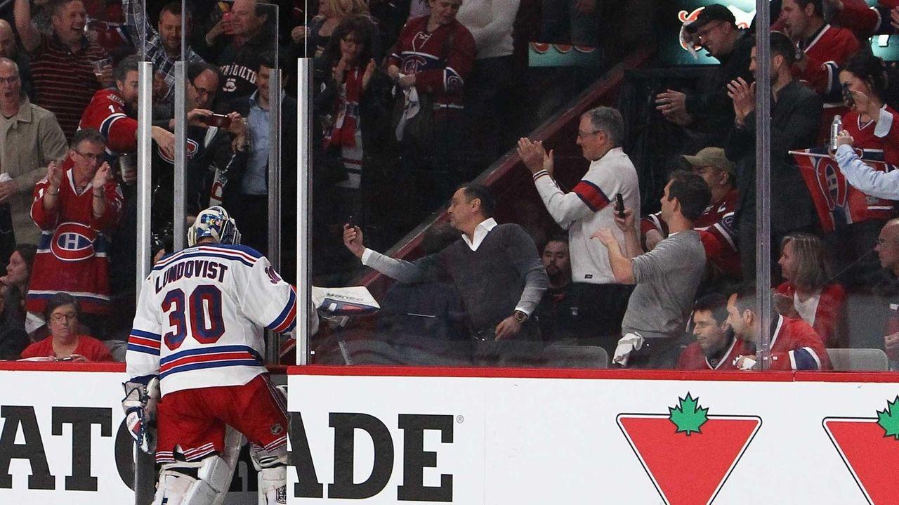 Henrik Lundqvist of the Rangers walks off the